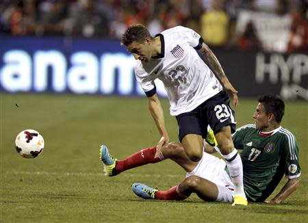 United States' Fabian Johnson (23) fights for the ball with Mexico's Jesus Zavala during the first half of their 2014 World Cup qualifying soccer match in Columbus, Ohio September 10, 2013. REUTERS/Matt Sullivan