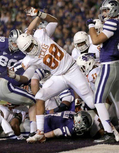 Kansas State quarterback Collin Klein, bottom, makes it into the end zone for a touchdown during the first half of an NCAA college football game against Texas, Saturday, Dec. 1, 2012, in Manhattan, Kan. (AP Photo/Charlie Riedel)