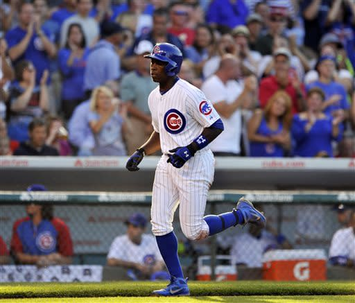 Chicago Cubs' Alfonso Soriano rounds the bases after hitting a solo home run during the third inning of a baseball game against the St. Louis Cardinals in Chicago, Saturday, July 13, 2013. (AP Photo/Paul Beaty)