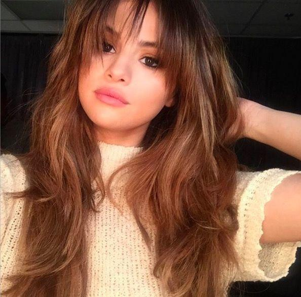 <p>Selena Gomez's fringe is a gorgeous, shaggy nod to the '70s. More 'woke-up-like-this' than Farrah Fawcett's face framing curls - this is 'cool girl' hippie style.</p>