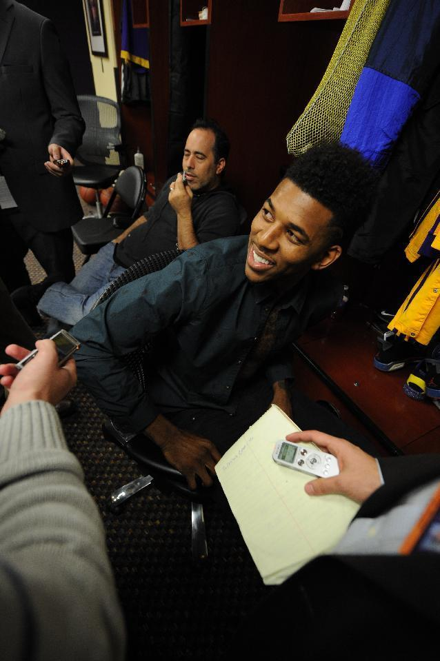 LOS ANGELES, CA - FEBRUARY 28: Nick Young #0 of the Los Angeles Lakers is interviewed after the game against the Sacramento Kings at Staples Center on February 28, 2014 in Los Angeles, California. (Photo by Andrew D. Bernstein/NBAE via Getty Images)