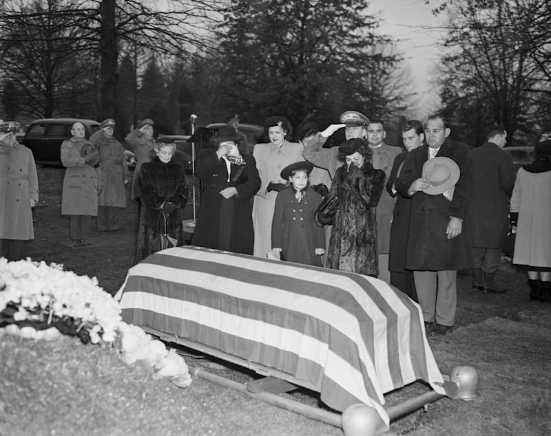 (Original Caption) 2/16/1949-Arlington, Virginia-The body of Felix Longoria, a Texas GI of Mexican descent whose family found trouble in paying him final honor in his home town, was buried today in Arlington National Cemetery. Longoria, 26-year-old Mexican-American from Three Rivers, TX, was killed in action in the Philippines. Left to right: Mrs. Guadelupe Longoria, mother; Mrs. Sara Marino, sister-in-law; Adelita the soldier's 8-year-old daughter; Corporate I. Wait, Army ceremonial aide and Mrs. Beatriz Longoria, his widow.