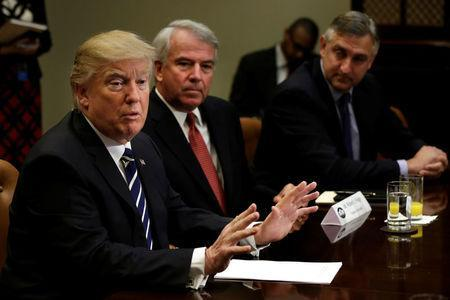 U.S. President Donald Trump talks with Pharma industry representatives as Robert Hugin (2nd R) Executive Chairman of Celgene and Robert Bradway (R) CEO of Amgen look on during a meeting at the White House in Washington, U.S., January 31, 2017. REUTERS/Yuri Gripas