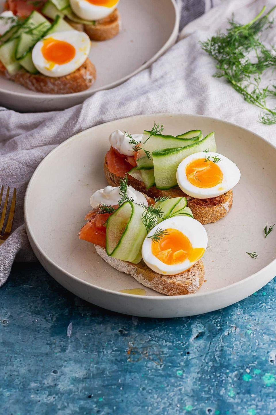 """<p>Crunchy toast, fresh smoked salmon, cucumber ribbons and creme fraiche, could you think of a more delicious breakfast? </p><p>Get the <a href=""""https://thecookreport.co.uk/smoked-salmon-toasts/"""" rel=""""nofollow noopener"""" target=""""_blank"""" data-ylk=""""slk:Smoked Salmon Toasts with Cucumber Ribbons"""" class=""""link rapid-noclick-resp"""">Smoked Salmon Toasts with Cucumber Ribbons</a> recipe.</p><p>Recipe from <a href=""""https://thecookreport.co.uk/"""" rel=""""nofollow noopener"""" target=""""_blank"""" data-ylk=""""slk:The Cook Report"""" class=""""link rapid-noclick-resp"""">The Cook Report</a>.</p>"""
