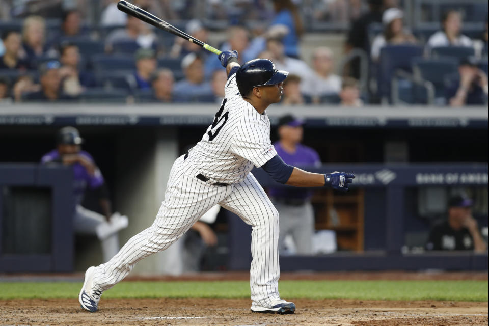 New York Yankees designated hitter Edwin Encarnacion watches his third-inning grand slam during the team's baseball game against the Colorado Rockies, Friday, July 19, 2019, in New York. (AP Photo/Kathy Willens)
