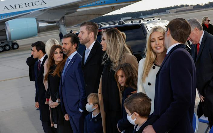 The president's family gathered at Joint Base Andrews for the ceremony - Reuters