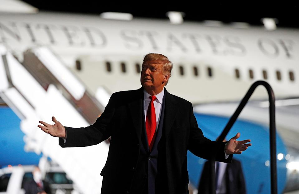 US President Donald Trump waves as he walks to board Marine One before departing for a campaign rally in Pennsylvania where he took a jab at Hillary Clinton. (Photo by NICHOLAS KAMM/AFP via Getty Images) (REUTERS)