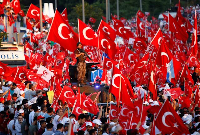 <p>People wave Turkey's national flags as they attend a ceremony marking the first anniversary of the attempted coup at the Bosphorus Bridge in Istanbul, Turkey, July 15, 2017. (Photo: Murad Sezer/Reuters) </p>