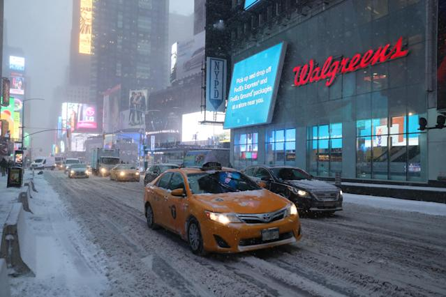 <p>Traffic makes its way through Times Square in New York, Thursday morning, Jan. 4, 2018. A massive winter storm swept from the Carolinas to Maine on Thursday, dumping snow along the coast and bringing strong winds that will usher in possible record-breaking cold. (Photo: Gordon Donovan/Yahoo News) </p>