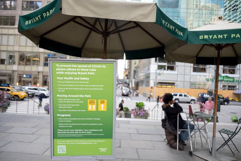 NEW YORK, NEW YORK - JUNE 24: A sign with information to stop the spread of COVID-19 is seen at the entrance to Bryant Park as the city moves into Phase 2 of re-opening following restrictions imposed to curb the coronavirus pandemic on June 24, 2020 in New York City. Phase 2 permits the reopening of offices, in-store retail, outdoor dining, barbers and beauty parlors and numerous other businesses. New York state plans on re-opening in four phases. (Photo by Alexi Rosenfeld/Getty Images)