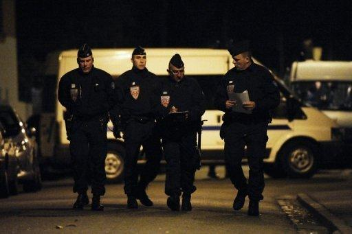 """French riot police patrol the perimeter of a siege on an apartment block where Mohamed Merah, the man suspected of a series of deadly shootings, was holed up in Toulouse, southwestern France. French police stepped up pressure Thursday on the besieged Al-Qaeda militant who boasted of having """"brought France to its knees"""" with a wave of brutal attacks that left seven dead"""