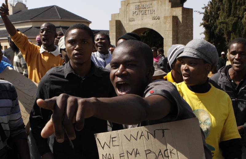 Protesters demonstrate outside the court in Ventersdorp, South Africa, Wednesday, Aug. 22 2012 at the sentencing of the killer of right wing leader Eugene TerreBlanche. Chris Mahlangu was given a life sentence for the 2010 murder of TerreBlanche.  (AP Photo/Denis Farrell)