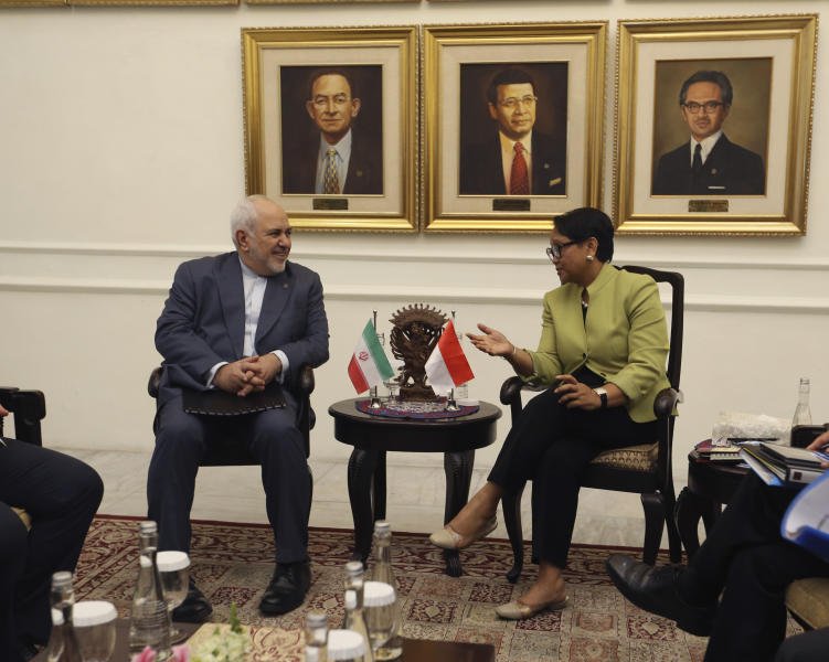 Iran's Foreign Minister Mohammad Javad Zarif, left, talks to his Indonesian counterpart Retno Marsudi during their meeting in Jakarta, Indonesia, Friday, Sept. 6, 2019. (AP Photo/Achmad Ibrahim)