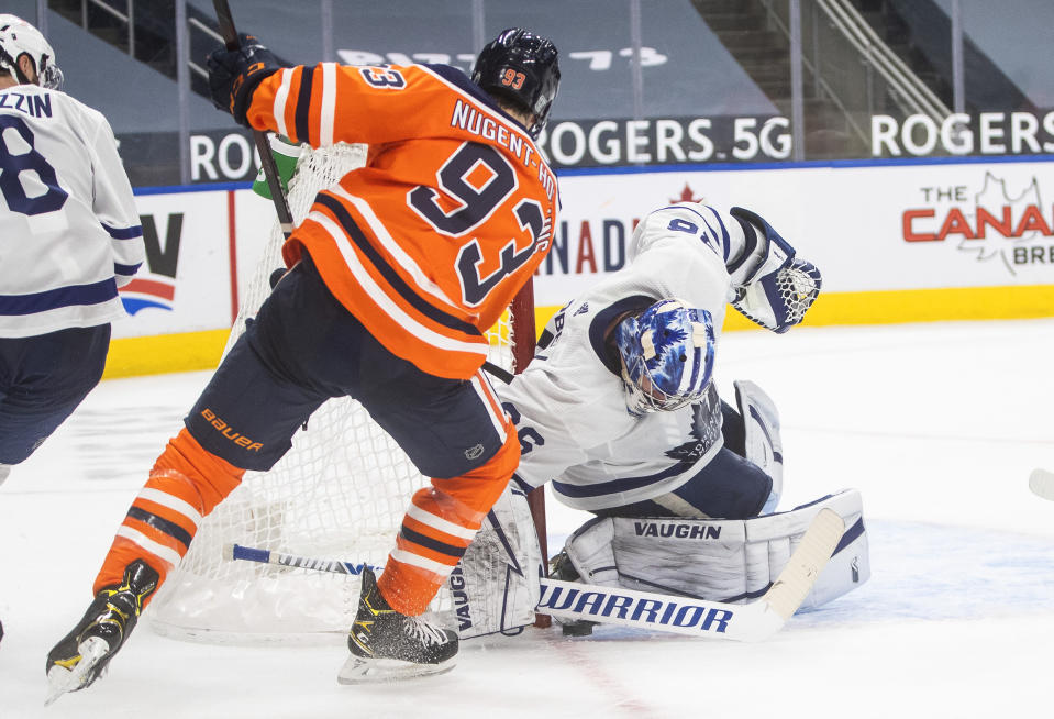 Edmonton Oilers' Ryan Nugent-Hopkins (93) is stopped by Toronto Maple Leafs goalie Jack Campbell (36) during the second period of an NHL game in Edmonton, Alberta, on Saturday, Feb. 27, 2021. (Jason Franson/The Canadian Press via AP)