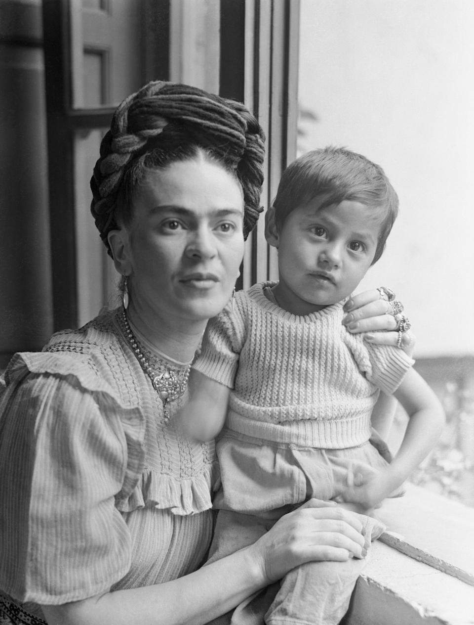 (Original Caption) Frida Kahlo, (1910-1954), Mexican painter and wife of Diego Rivera is shown here with child.