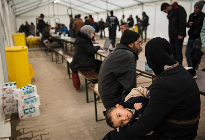 Newly arrived immigrants are pre-registered, allowing them to be bussed to a newly opened asylum seeker registration centre, at the Office of Health and Social Affairs LAGESO in Berlin on October 15, 2015 (AFP Photo/Odd Andersen)