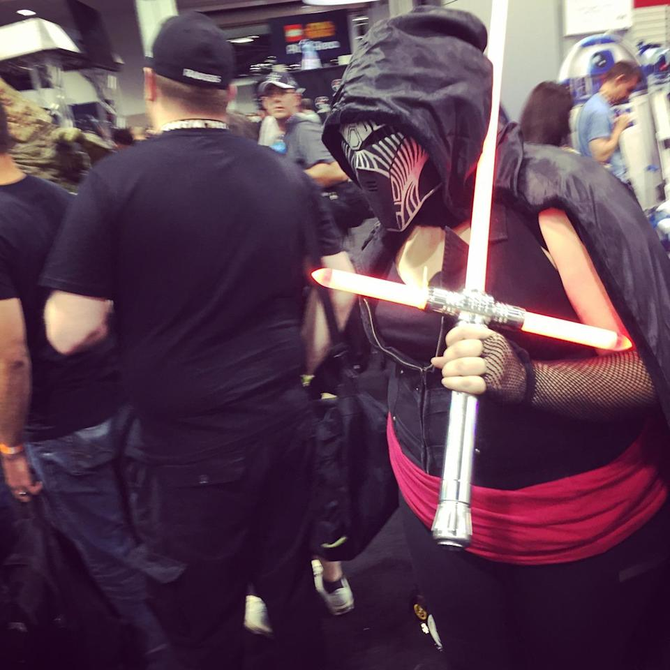 The new tri-blade saber was a big hit at the Celebration. But this Dark Sider needs to be careful where she sets that thing. Don't need any unnecessary decapitations.