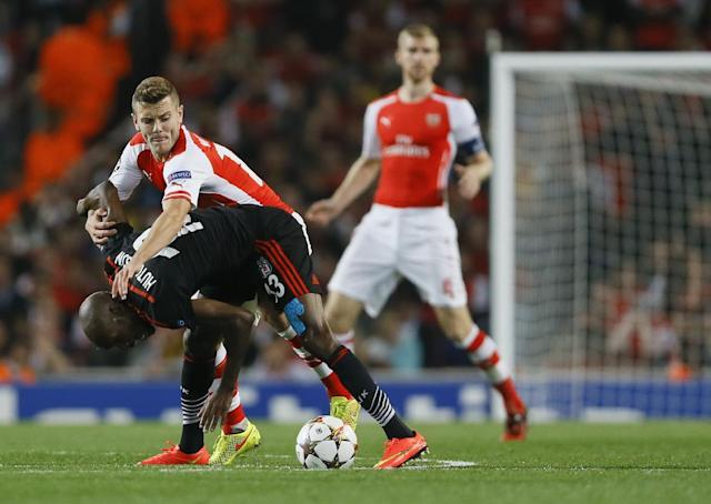 Arsenal's Jack Wilshere, top left, vies for the ball with Besiktas' Atiba Hutchinson during a second leg Champions League qualifying soccer match between Arsenal and Besiktas at Emirates Stadium in London Wednesday, Aug. 27, 2014.(AP Photo/Kirsty Wigglesworth)