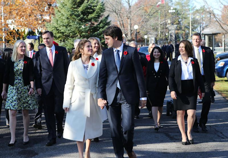 Incoming Canadian Prime Minister Justin Trudeau and his wife Sophie Gregoire arrive with his cabinet before his swearing-in as Canada's 23rd prime minister at Rideau Hall in Ottawa on November 4, 2015. AFP PHOTO/POOL/BLAIR GABLE (Photo by - / POOL / AFP) (Photo by -/POOL/AFP via Getty Images)