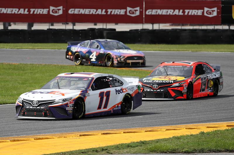 DAYTONA BEACH, FLORIDA - AUGUST 16: Denny Hamlin, driver of the #11 FedEx Freight Toyota, leads Martin Truex Jr., driver of the #19 Bass Pro Shops Toyota, and Kevin Harvick, driver of the #4 Busch Beer National Forest Foundation Ford, during the NASCAR Cup Series Go Bowling 235 at Daytona International Speedway on August 16, 2020 in Daytona Beach, Florida. (Photo by Chris Graythen/Getty Images)