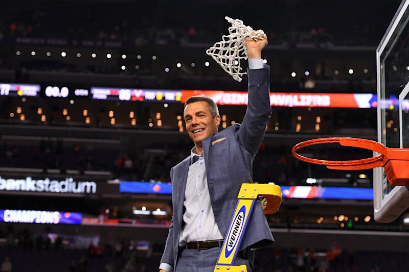 MINNEAPOLIS, MINNESOTA - APRIL 08: Head coach Tony Bennett of the Virginia Cavaliers raises the net after defeating the Texas Tech Red Raiders in the 2019 NCAA men's Final Four National Championship game at U.S. Bank Stadium on April 08, 2019 in Minneapolis, Minnesota. (Photo by Jamie Schwaberow/NCAA Photos via Getty Images)