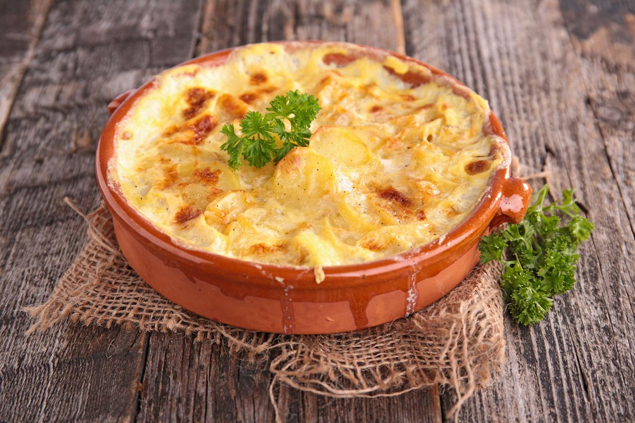 """<p>It doesn't matter if you call them scalloped potatoes or potatoes au gratin—our list of the best scalloped potatoes recipes will make all your carb-filled and cheese-loaded dreams true. Growing up, you probably enjoyed one of these comforting <a href=""""https://www.countryliving.com/food-drinks/g1050/simple-potato-recipes-1110/"""">potato recipes</a> as a <a href=""""https://www.countryliving.com/food-drinks/g896/thanksgiving-side-dishes/"""">side dish</a> for your <a href=""""https://www.countryliving.com/food-drinks/g637/thanksgiving-menus/"""">Thanksgiving feast</a> or <a href=""""https://www.countryliving.com/food-drinks/g635/holiday-recipe-book-1108/"""">Christmas dinner</a>. Some versions take a decent amount of time to prepare, so it's understandable why they were saved for a special occasion. But many of these recipes are baked under an hour, so you could even whip up homemade scalloped potatoes for a <a href=""""https://www.countryliving.com/food-drinks/g648/quick-easy-dinner-recipes/"""">weeknight supper</a>. </p><p>In fact, a few of these are actually made right in your <a href=""""https://www.countryliving.com/food-drinks/g1903/slow-cooker-recipes/"""">slow cooker</a>, so you can let the handy device do all the work. (It doesn't get much easier than that!) A <a href=""""https://www.countryliving.com/food-drinks/g3209/healthy-crock-pot-recipes/"""">Crock-Pot</a> scalloped potato recipe would actually be ideal to make for your <a href=""""https://www.countryliving.com/food-drinks/g22546745/vegetarian-thanksgiving/"""">holiday meal</a>, because it's one less side dish that needs to go in the oven. All you need to do is toss everything into the appliance, and then you can be free to prepare the many <a href=""""https://www.countryliving.com/food-drinks/g4710/thanksgiving-salad/"""">other plates</a>. It doesn't matter when you decide to bake one of these <a href=""""https://www.countryliving.com/food-drinks/g1279/casserole-dinner-recipes/"""">crowd-pleasing casseroles</a>, whether it's for a special occasion, a ho"""
