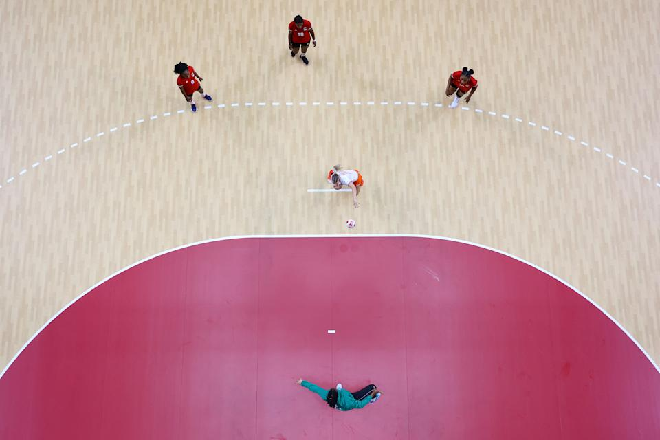 <p>Angela Malestein of Team Netherlands takes a penalty against Helena Sousa of Team Angola during the Women's Preliminary Round Group A handball match between Netherlands and Angola on day six of the Tokyo 2020 Olympic Games at Yoyogi National Stadium on July 29, 2021 in Tokyo, Japan. (Photo by Richard Heathcote/Getty Images)</p>