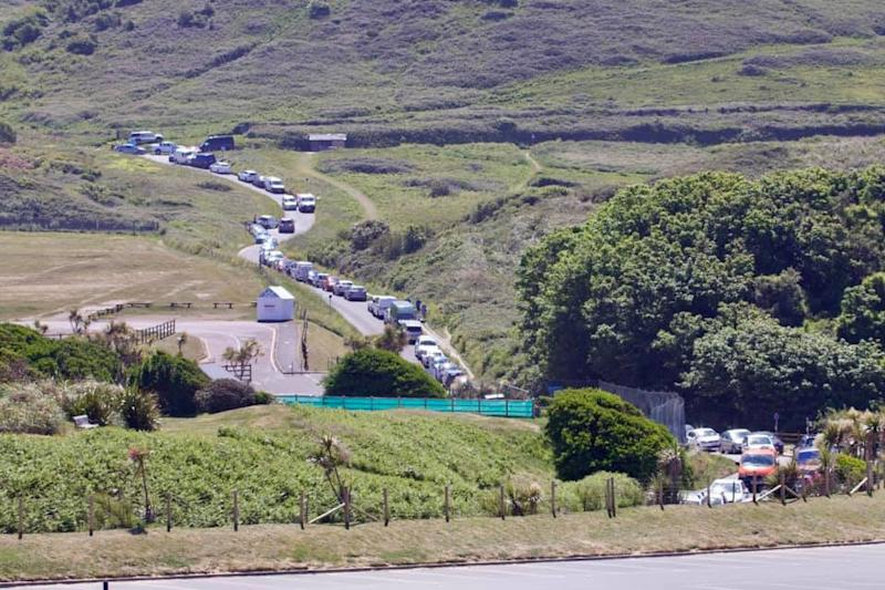 "Traffic on the approach to Woolacombe, Devon. See SWNS story SWPLbeach. Sun-seekers have been flocking to coastal hot-spots in the Westcountry in such numbers traffic wardens have reportedly run out of TICKETS. Several routes into beaches in Devon have been left clogged with traffic with roads described as ""exceptionally busy."" Cops say several beach car parks had to be closed as people flocked to the seaside to take advantage of the hottest day of the year. Warnings had been issued urging people to stay away despite the lifting of lockdown restrictions."