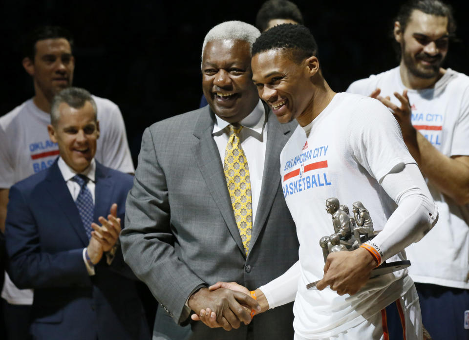 FILE - Then-Oklahoma City Thunder guard Russell Westbrook, right, is congratulated by Oscar Robertson on his single season triple-double record before an NBA basketball game between the Denver Nuggets and the Oklahoma City Thunder in Oklahoma City, Okla., in this Wednesday, April 12, 2017, file photo. Westbrooks stat lines have been looking like typos in the box score lately, and now hes on the verge of something historic. The Washington Wizards point guards next triple-double which could come as soon as Saturday, May 8, 2021, will be the 181st of his career, tying Oscar Robertsons NBA record. (AP Photo/Sue Ogrocki, File)