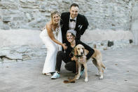 In this Oct. 19, 2018 photo, Lara Leinen of Doggy Social MN LLC poses with Lindsay and Kyle Hofer, and their dog Carter, at their wedding in Minneapolis, Minn. It's no longer unusual for brides and grooms to include pets in their wedding photos or even in the ceremony. But it can be tough to manage that along with everything else. (Russell Heeter Photography/Lara Leinen via AP)