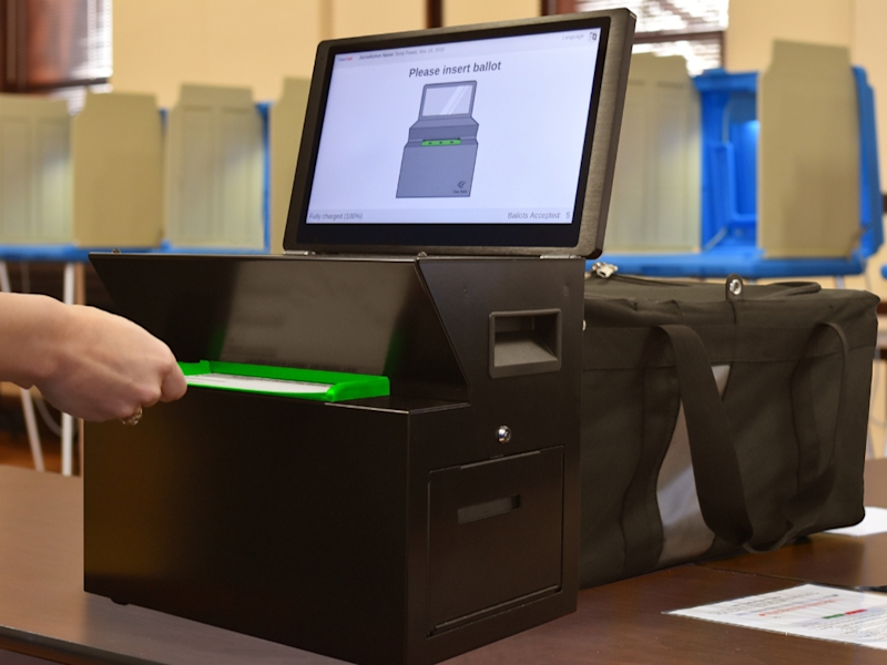 Some ballots provided by a vendor were a fraction of an inch to wide to fit into scanners on the county's new voting machines.