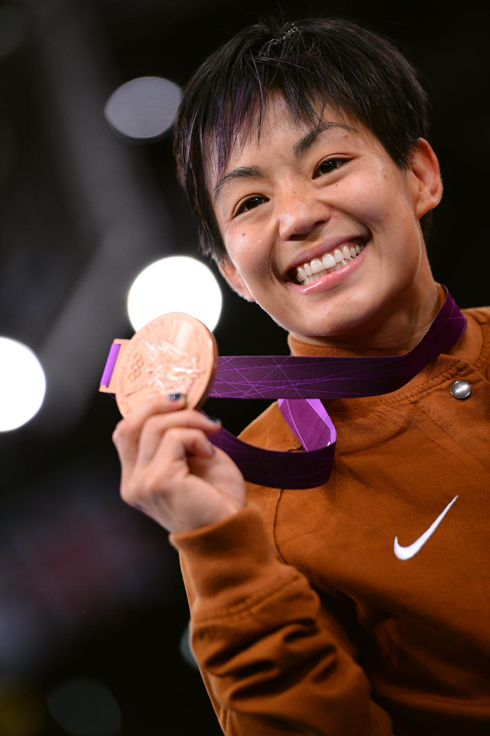 """Bronze medalist A <a href=""""http://sports.yahoo.com/olympics/wrestling/clarissa-kyoko-mei-ling-chun-1130413/"""" data-ylk=""""slk:Clarissa Kyoko Mei Ling Chun"""" class=""""link rapid-noclick-resp"""">Clarissa Kyoko Mei Ling Chun</a> of the United States stands on the podium in the Women's Freestyle 48 kg Wrestling on Day 12 of the London 2012 Olympic Games at ExCeL on August 8, 2012 in London, England. (Photo by Lars Baron/Getty Images)"""