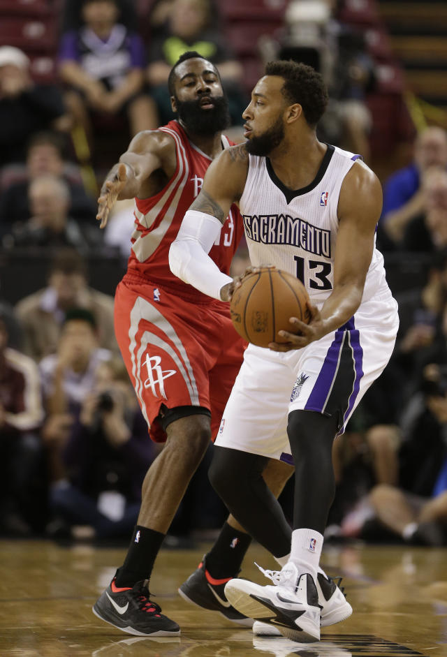 Sacramento Kings forward Derrick Williams, (13) tries to pass off against Houston Rockets guard James Harden during the first quarter of an NBA basketball game in Sacramento, Calif., Tuesday Feb. 25, 2014.(AP Photo/Rich Pedroncelli)