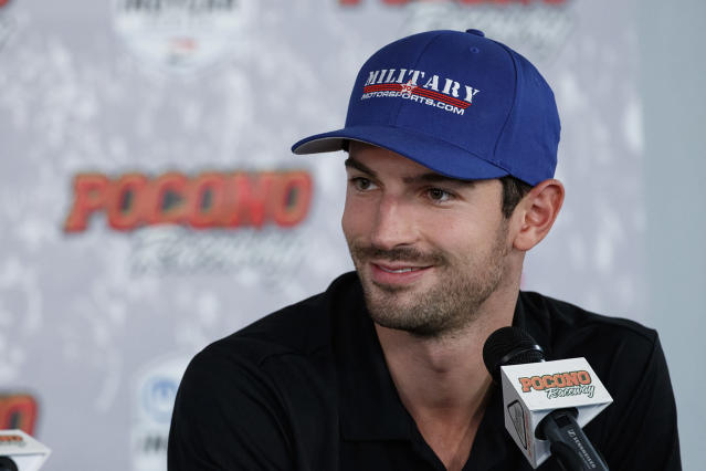FILE - In this Aug. 17, 2019, file photo, Alexander Rossi smiles during a news conference for an IndyCar Series auto race at Pocono Raceway, in Long Pond, Pa. Josef Newgarden leads Rossi in the IndyCar standings heading into this weekend's finale at Laguna Seca Raceway in Monterey, Calif. (AP Photo/Matt Slocum, File)