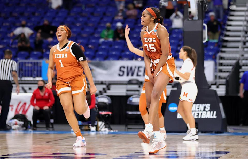 Charli Collier #35 and Lauren Ebo #1 of the Texas Longhorns celebrate after beating Maryland in the Sweet 16 on March 28, 2021