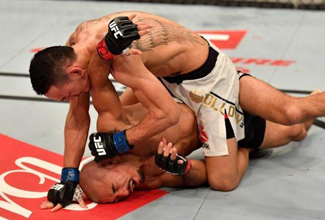 Max Holloway finishes off Jose Aldo Saturday in their featherweight title unification bout at UFC 212 in Rio de Janeiro. (Getty Images)