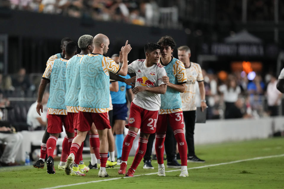 New York Red Bulls midfielder Omir Fernandez, center, is congratulated by teammates after scoring against Inter Miami during the first half of an MLS soccer match Friday, Sept. 17, 2021, in Fort Lauderdale, Fla. (AP Photo/Rebecca Blackwell)