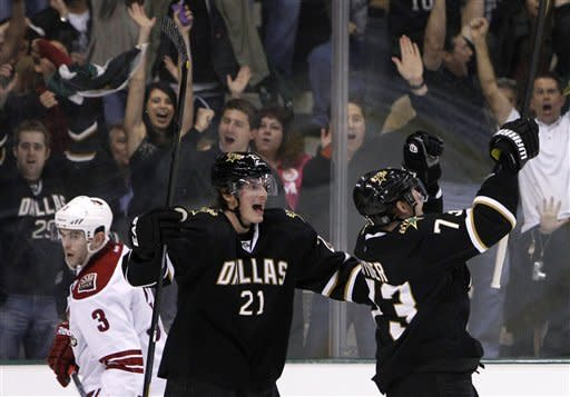 Phoenix Coyotes' Keith Yandle (3) skates away as Dallas Stars' Loui Eriksson (21), of Sweden, celebrates with Michael Ryder, right, following one of Ryder's goal in the second period of an NHL hockey game Tuesday, March 20, 2012, in Dallas. The goal was Ryder's second of the period. (AP Photo/Tony Gutierrez)