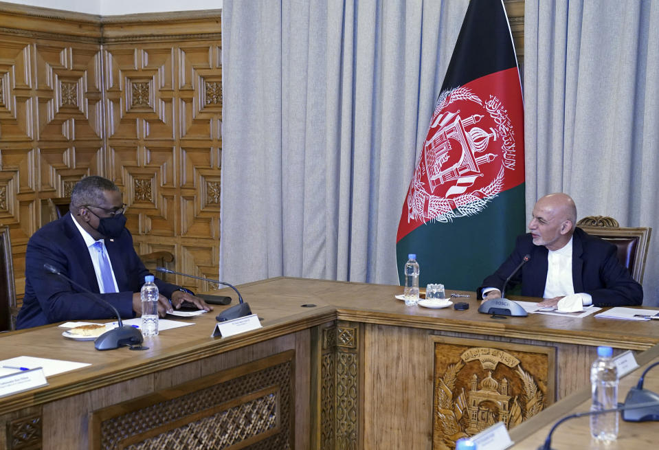 U.S. Defense Secretary Lloyd Austin, left, meets Afgan President Ashraf Ghani at the presidential palace in Kabul, Afghanistan, Sunday, March 21, 2021. Austin arrived in Kabul on his first trip to Afghanistan as Pentagon chief, amid swirling questions about how long American troops will remain in the country. (Presidential Palace via AP)