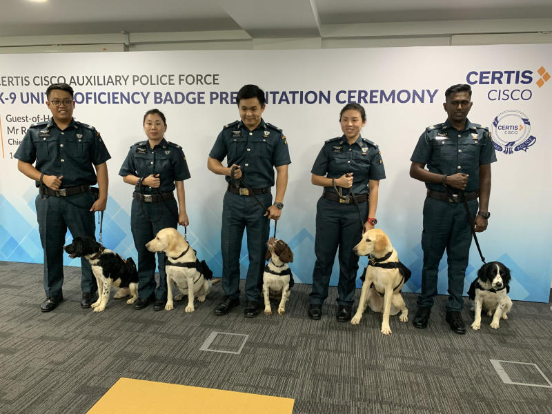 Certis Cisco Auxiliary police officers with their canine colleagues. From left: Corporal Lee Si Xian and Bonzo, corporal Chang Li Ting and Naomi, corporal Kelvin Wong Jia Wei and Peppe, corporal Lee Sin Nie and Aspa, and sergeant Yogeswaran Subramaniam and Turbo. (Photo: Amir Hussain/Yahoo News Singapore)