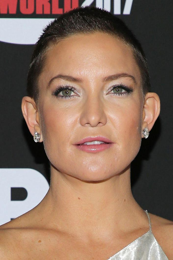 <p>Perhaps her roots were a giveaway, but it sure does seem like Kate's hair is growing back in from a recent buzz cut in a rather dark brown shade.</p>