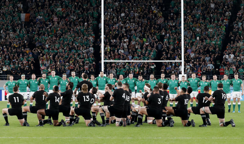 New Zealand's players perform haka ahead of the Rugby World Cup quarterfinal match at Tokyo Stadium between New Zealand and Ireland in Tokyo, Japan, Saturday, Oct. 19, 2019. (AP Photo/Eugene Hoshiko)