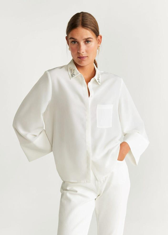 """This top comes in sizes 4 to 10. <a href=""""https://fave.co/2viHA70"""" rel=""""nofollow noopener"""" target=""""_blank"""" data-ylk=""""slk:Find it at Mango for $40"""" class=""""link rapid-noclick-resp"""">Find it at Mango for $40</a>."""