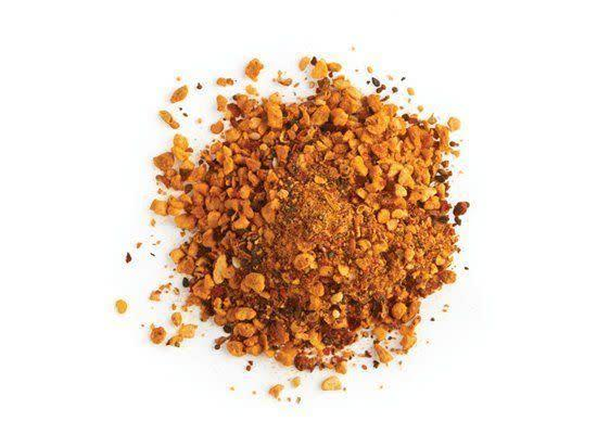 """<em>shi-CHEE-mee toe-guh-RAH-she</em> A seven-spice mixture (<em>shichimi</em> means seven) of red chili pepper, Sichuan pepper, roasted orange peel, black and white sesame seeds, hemp seeds, poppy seeds, ground ginger and nori (dried seaweed). <strong>How to Use:</strong> Use shichimi as a condiment, sprinkled on Asian noodle dishes and soups, such as ramen. <strong>Origin:</strong> Japan <strong>Recipe: </strong> <a href=""""http://www.huffingtonpost.com/2012/02/27/spicy-miso-ramen-noodle-s_n_1304702.html"""" rel=""""nofollow noopener"""" target=""""_blank"""" data-ylk=""""slk:Spicy Miso Ramen Noodle Soup"""" class=""""link rapid-noclick-resp"""">Spicy Miso Ramen Noodle Soup</a> <strong><a href=""""http://www.deandeluca.com/herbs-and-spices/herbs-spices/shichimi-togarashi.aspx"""" rel=""""nofollow noopener"""" target=""""_blank"""" data-ylk=""""slk:Shichimi Togarashi"""" class=""""link rapid-noclick-resp"""">Shichimi Togarashi</a> at DeanandDeluca.com, $30</strong>"""