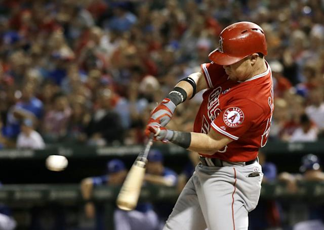 Los Angeles Angels' Kole Calhoun (56) prepares to connect for a sacrifice fly out to right that scored Andrew Romine off a pitch from Texas Rangers' Alexi Ogando in the third inning of a baseball game, Friday, Sept. 27, 2013, in Arlington, Texas. (AP Photo/Tony Gutierrez)
