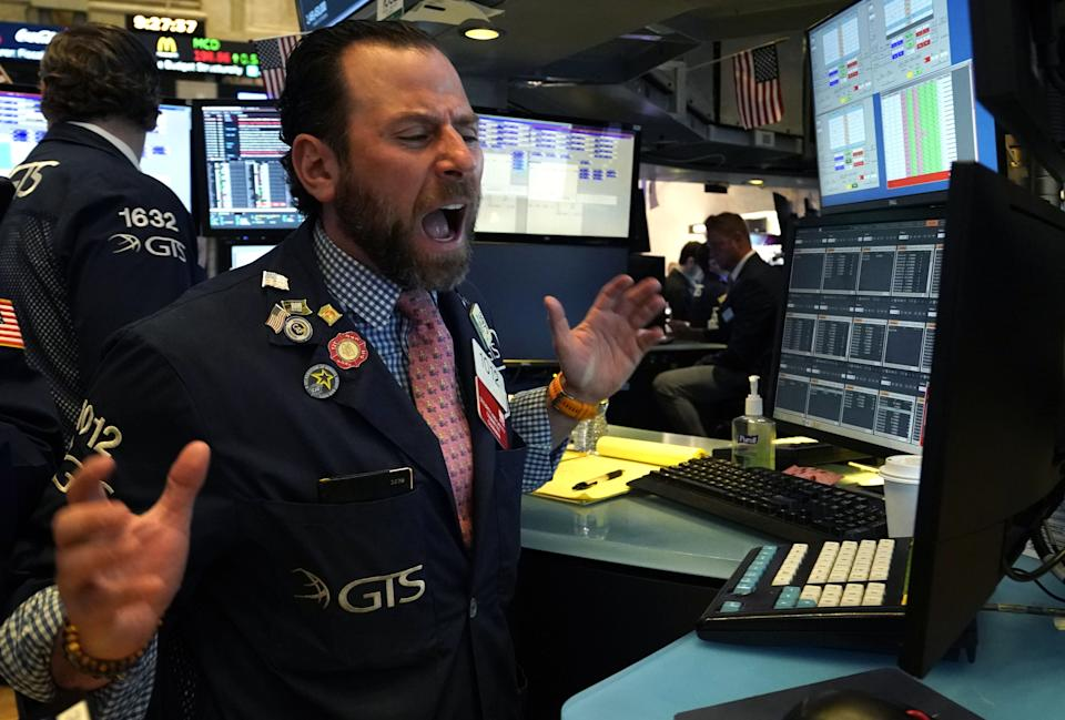 A trader reacts as he works on the floor during the opening bell on the New York Stock Exchange on March 9, 2020 in New York. - Trading on Wall Street was temporarily halted early March 9, 2020 as US stocks joined a global rout on crashing oil prices and mounting worries over the coronavirus.The suspension was triggered after the S&P 500's losses hit seven percent. Near 1340 GMT, the broad-based index was down more than 200 points at 2,764.21. (Photo by TIMOTHY A. CLARY / AFP) (Photo by TIMOTHY A. CLARY/AFP via Getty Images)