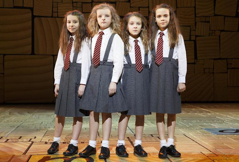 """This theater publicity image released by Boneau/Bryan-Brown shows the four actresses who share the title role in """"Matilda The Musical,"""" from left, Bailey Ryon, Milly Shapiro, Sophia Gennusa, and Oona Laurence on stage at the Shubert Theatre in New York. (AP Photo/Boneau/Bryan-Brown, Joan Marcus)"""