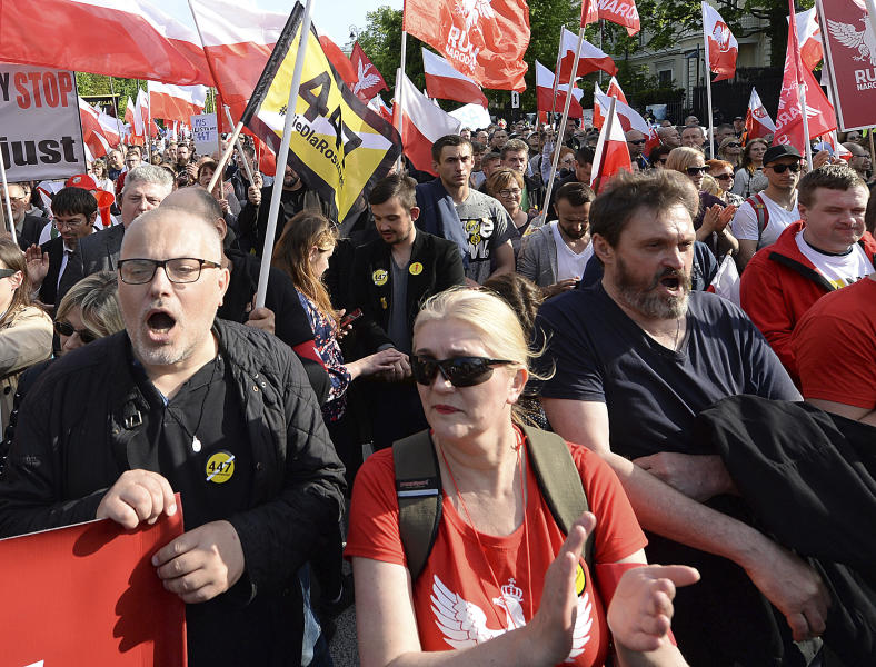 "Thousands of Polish nationalists march to the U.S. Embassy, in Warsaw, Poland, Saturday, May 11, 2019. Thousands of Polish nationalists have marched to the U.S. Embassy in Warsaw, protesting that the U.S. is putting pressure on Poland to compensate Jews whose families lost property during the Holocaust. The protesters included far-right groups and their supporters. They said the United States has no right to interfere in Polish affairs and that the U.S. government is putting ""Jewish interests"" over the interests of Poland. (AP Photo/Czarek Sokolowski)"