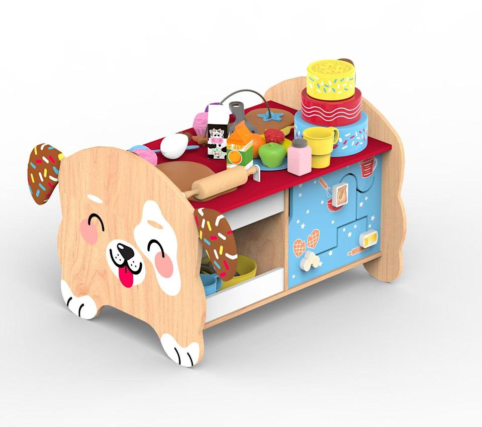 "<p>Let their sweet imaginations run wild! There's so much fun packed into this activity bench: Kids can stack and count the layers of a cake, pretend to roll and cut out cookies, put treats in the oven or follow the maze on the fridge door. The set is two feet tall and comes with 18 accessories. It's part of KidKraft's ""Foody Fun"" line, which also includes a cooking elephant activity center.</p><p><em>Ages 2+<br>$80<br>Available Summer 2021</em></p>"