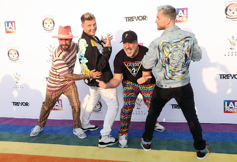 """(L-R) AJ McLean and Nick Carter of Backstreet Boys and Joey Fatone and Lance Bass of NSYNC attend """"Bingo Under The Stars"""" at The Grove on June 18, 2021 in Los Angeles, California."""
